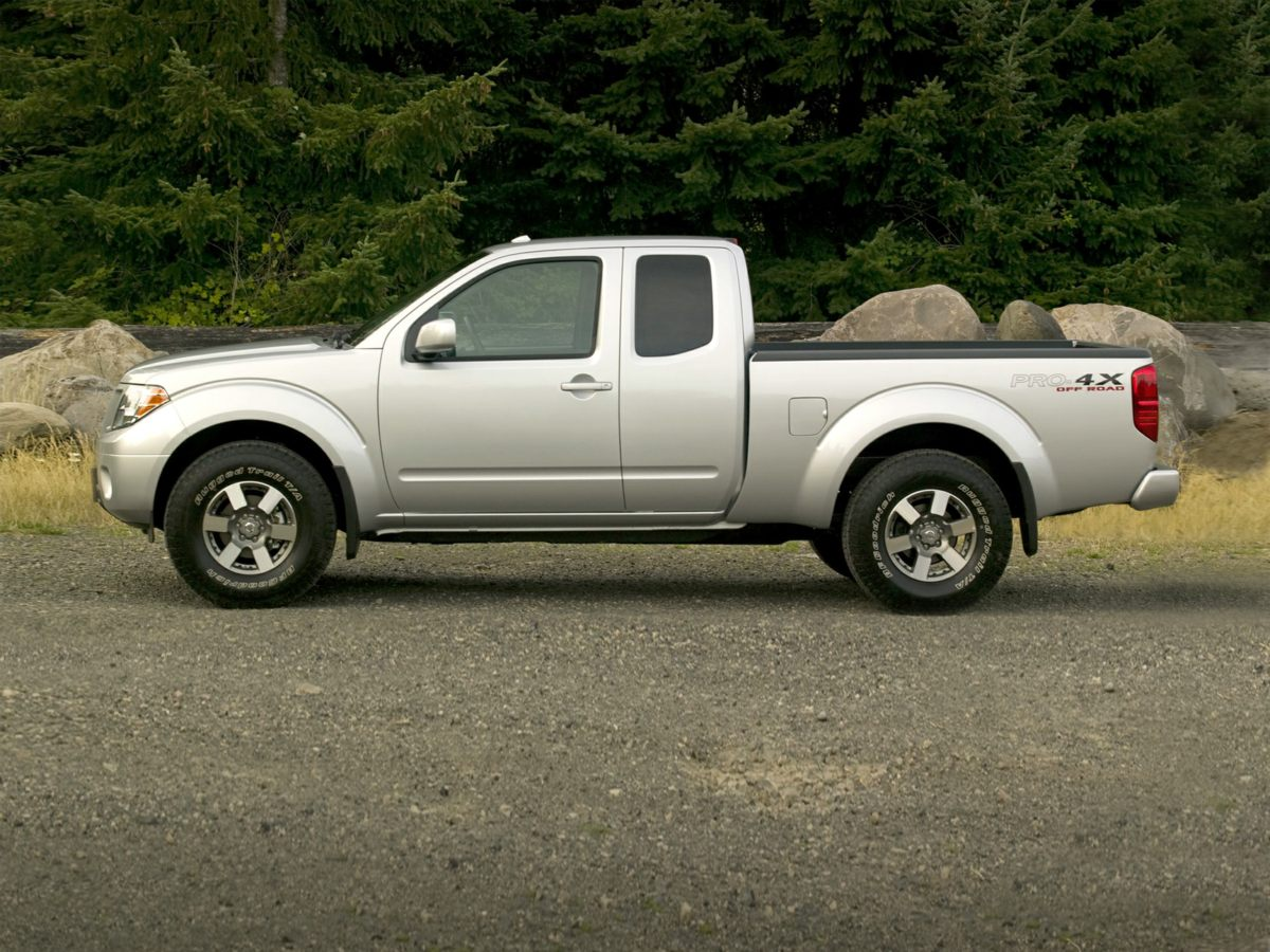 2015 Nissan Frontier SV White Frontier SV and 4D Crew Cab A total gas saver Fuel Efficient If