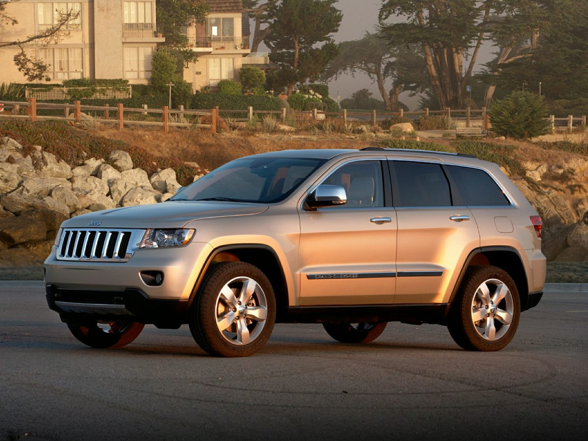 2011 Jeep Grand Cherokee Overland Beige You NEED to see this SUV The Mac Haik Dodge Chrysler Jeep