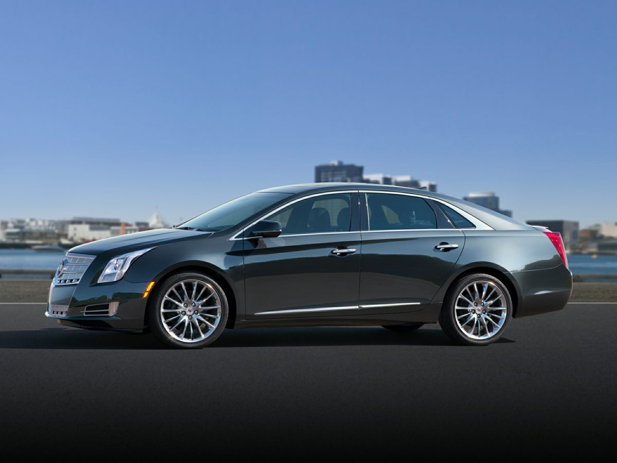 2015 Cadillac XTS Black Stability and traction control are road adaptive Seize the road with sol