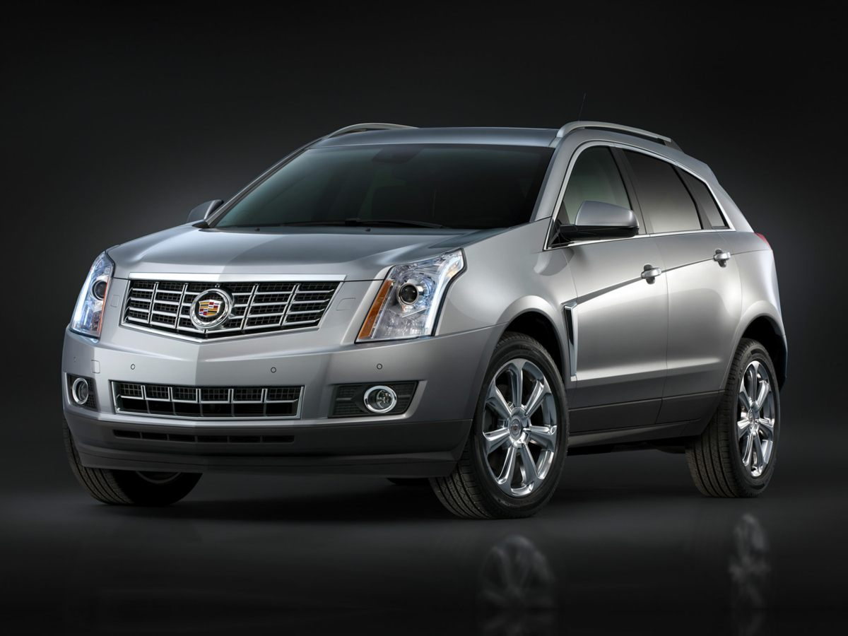 2015 Cadillac SRX Luxury Black Smile as you swiftly drive past another gas station Direct steeri