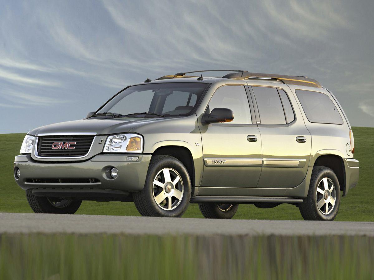 2005 GMC Envoy XL SILVER CD player Bumpers: body-color